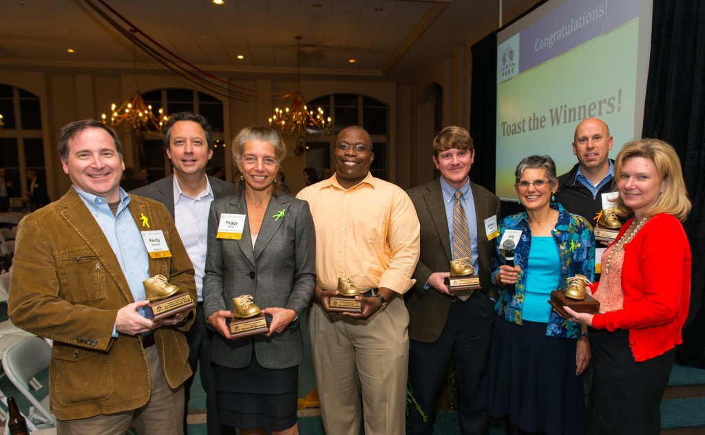 The 2013 PEDS Golden Shoe award winners. Randy Guensler is on the far left, Peggy Berg is second from left.