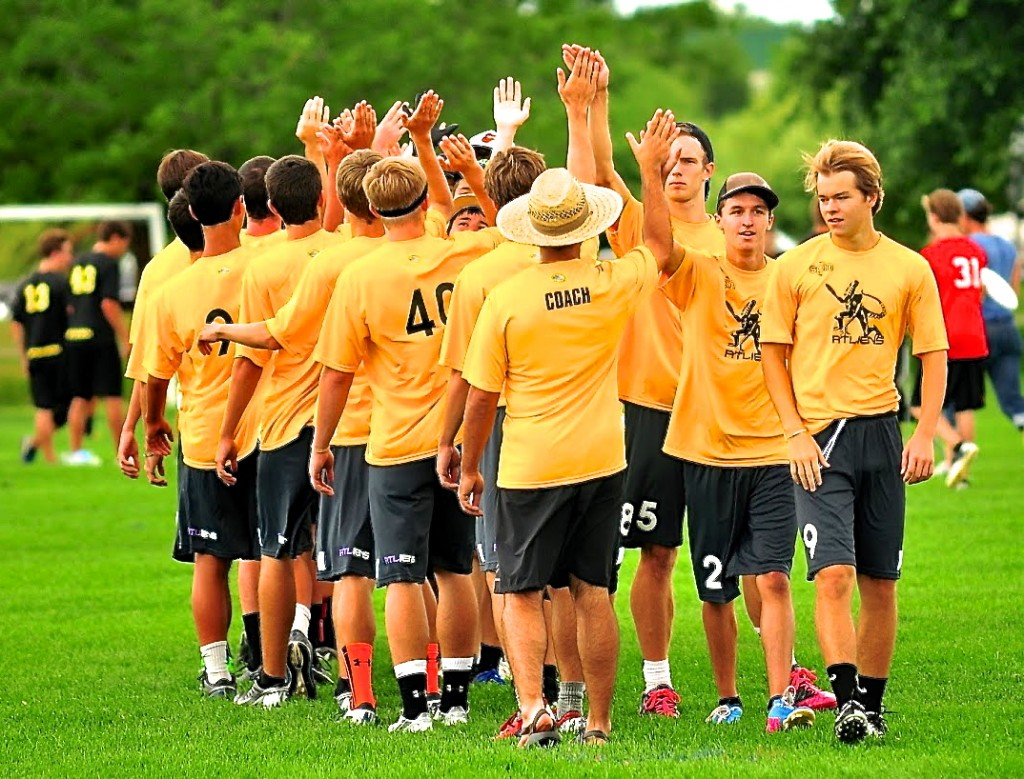 Team high fives after an opening round victory. Photo courtesy Rob Brownell.