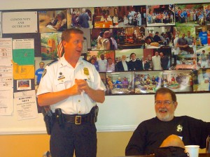 APD Captain Brent Schierbaum makes a point to the group while John Wolfinger listens.