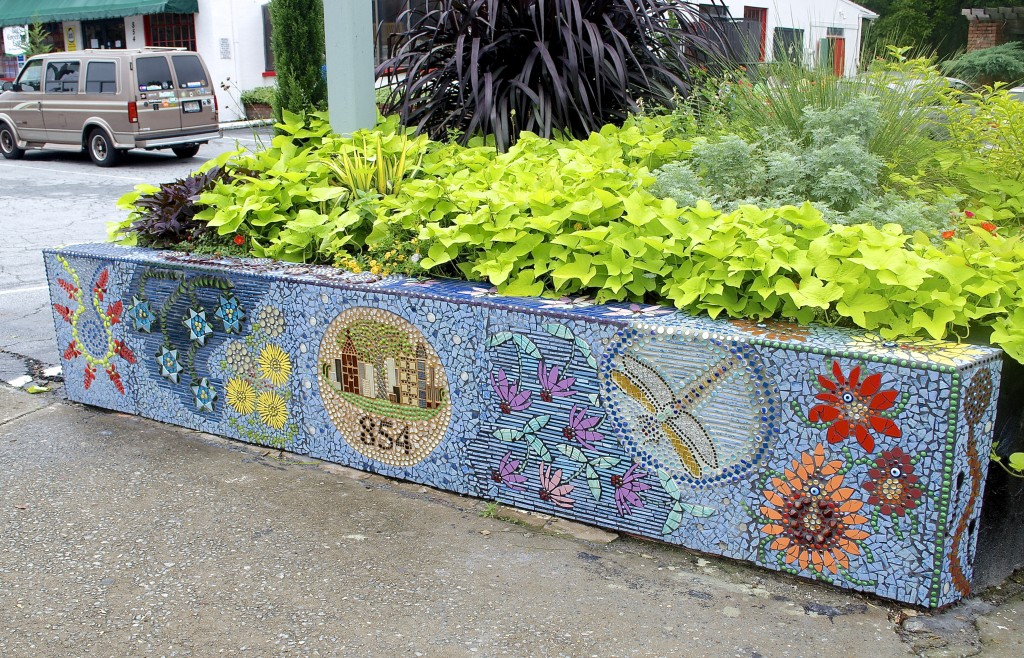 Coffin's newest mosaic - Atlanta Afloat - adorns the wall of the Intown Ace Hardware planter that faces N. Highland Ave.