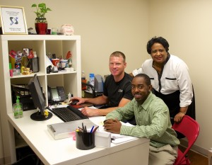 Briarcliff Summit property manager Annie Copeland (right) with relocation coordinator Brandon Copeland (front) and technician Brian Arterburn