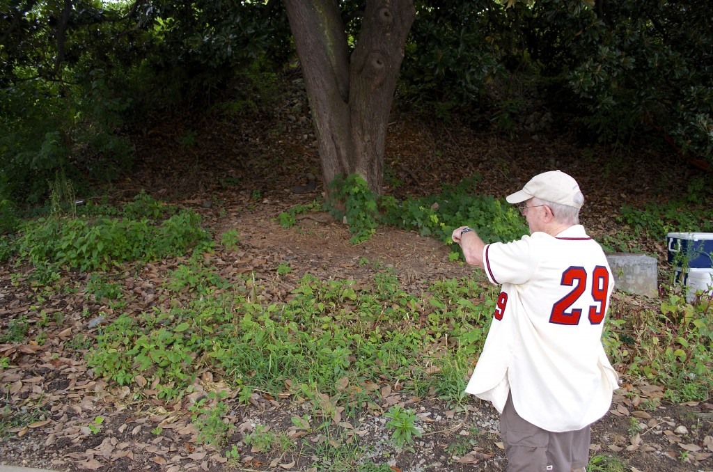 Oreon Mann points out where he and his stepmother buried his father's ashes when he died in 1990.