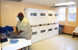 Resident Michael Rogers uses the newly renovated laundry room