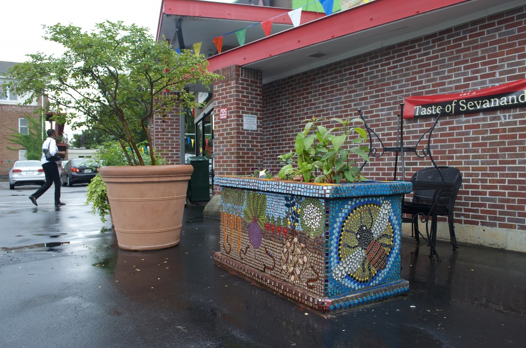 Coffin created a 4-sided mosaic for this planter outside the front door at Sevananda in L5P. View our photo album (link below) for photos of the other three sides.