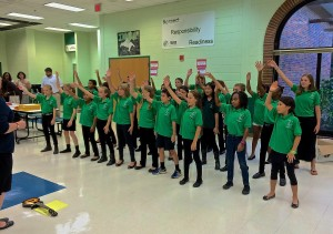 The SPARK Advanced Chorus performed before the meeting.