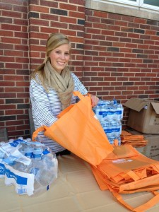 Tour of Homes volunteer Allie Fenn assembles bags for tour-goers