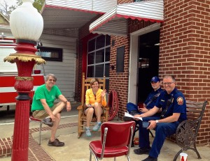 VHCA board members Jack White and Catherine Lewis, left and center, talk with firemen outside FS #19.