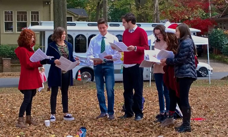 Carolers from Grady High School entertained tour-goers.